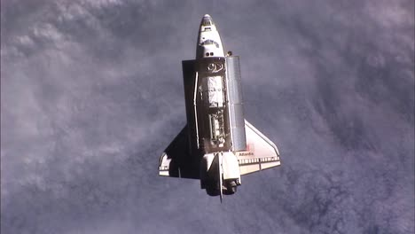 The-Space-Shuttle-Atlantis-In-Flight-From-Above