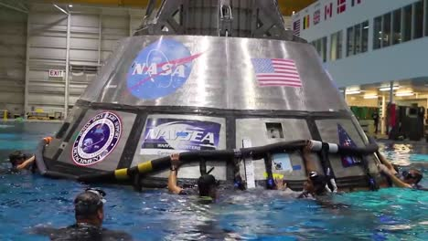 Nasa-Engineers-Practice-Splashdown-Rescue-With-The-Orion-Capsule-At-The-Johnson-Space-Center