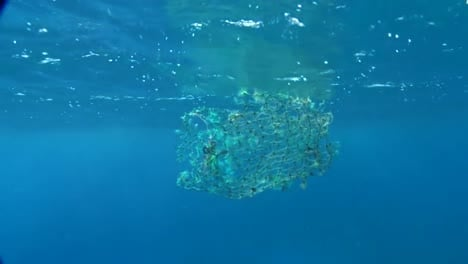 Underwater-View-Of-A-Broken-Net-Which-Could-Ensnare-And-Trap-Marine-Animals
