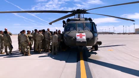 Fast-Move-Up-To-An-Army-Red-Cross-Helicopter-Air-Ambulance-Service-With-Troops-Nearby