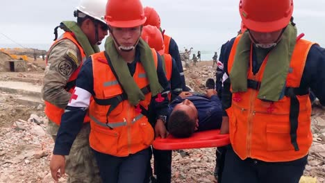 Peruvian-Army-Search-And-Rescue-Specialists-Work-On-Injured-Survivors-Of-A-Mock-Disaster-On-A-Beach-In-Lima-Peru