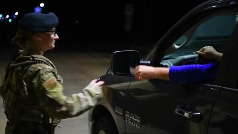 A-Female-Soldier-Guard-Mans-A-Checkpoint-At-The-Entry-Gate-Of-A-Us-Military-Base