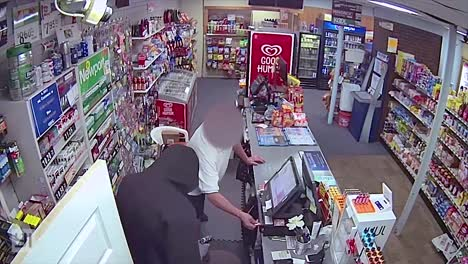 A-Hooded-Man-Robs-A-Convenient-Store-During-An-Armed-Robbery-In-Dedham-Massachusetts