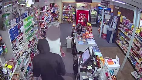 A-Hooded-Man-Robs-A-Convenient-Store-During-An-Armed-Robbery-In-Dedham-Massachusetts-1