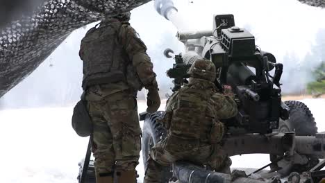Us-Army-Artillery-Soldiers-Fire-A-Massive-Howitzer-Cannon-Gun-On-The-Battlefield