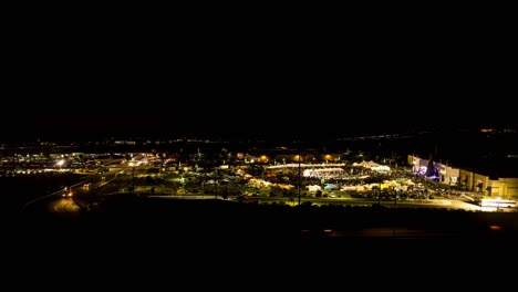 Time-Lapse-Sunset-Behind-A-Carnival-Or-Fair-Held-In-A-Mall-Parking-Lot-With-Crowds-And-Booths-And-Rides