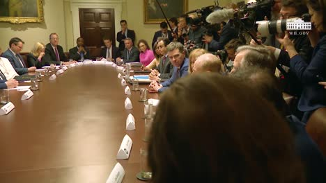 Us-President-Donald-Trump-Hosts-A-Large-Round-Table-Meeting-Of-Officials-At-The-White-House