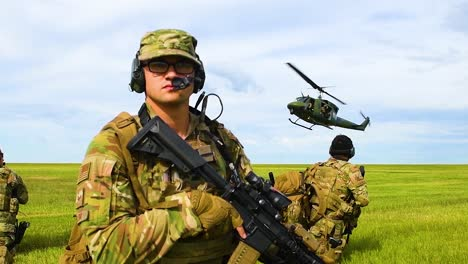 A-Huey-Helicopter-Lands-On-A-Grassy-Plain-With-Us-Servicement-And-Forces-Guarding-The-Mission-In-Slow-Motion
