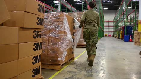 Surgical-Masks-And-Gowns-And-Other-Protective-Medical-Supplies-Are-Delivered-By-The-National-Guard-To-Affected-Sites-During-Covid19-Coronavirus-Outbreak-Epidemic-2
