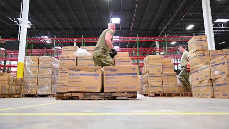 Surgical-Masks-And-Gowns-And-Other-Protective-Medical-Supplies-Are-Delivered-By-The-National-Guard-To-Affected-Sites-During-Covid19-Coronavirus-Outbreak-Epidemic-11