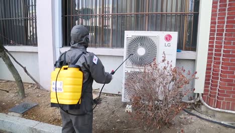 South-Korea-Takes-Aggressive-Action-Against-The-Coronavirus-Covid19-Virus-Pandemic-Outbreak-With-Us-Army-Collaboration-Spraying-Of-Disinfectant-On-Buildings