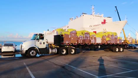Surgical-Masks-And-Gowns-And-Other-Protective-Medical-Supplies-Are-Trucked-To-The-Us-Navy-Mercy-Hostpital-Ship-During-Covid19-Coronavirus-Outbreak-Epidemic
