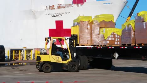 Surgical-Masks-And-Gowns-And-Other-Protective-Medical-Supplies-Are-Trucked-To-The-Us-Navy-Mercy-Hostpital-Ship-During-Covid19-Coronavirus-Outbreak-Epidemic-2