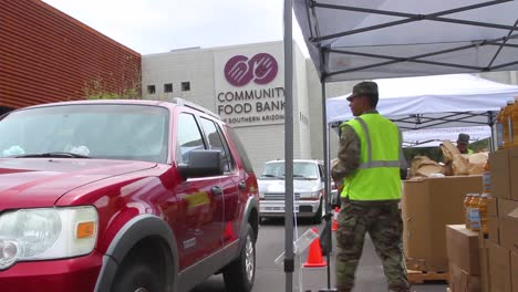 During-The-Covid19-Coronavirus-Epidemic-Outbreak-Members-Of-The-Armed-Forces-Hand-Out-Groceries-At-A-Food-Bank-In-Arizona
