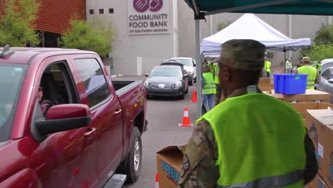During-The-Covid19-Coronavirus-Epidemic-Outbreak-Members-Of-The-Armed-Forces-Hand-Out-Groceries-At-A-Food-Bank-In-Arizona-1