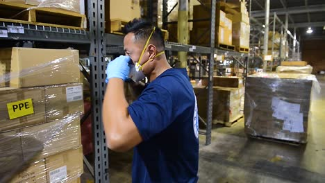 Workers-In-A-Warehouse-Deliver-Goods-To-Maintain-Supply-Chain-Economics-During-The-Coronavirus-Covid19-Epidemic