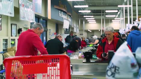 Shoppers-Crowd-And-Hoard-Food-At-A-Supermarket-During-The-Early-Days-Of-The-Covid19-Coronavirus-Epidemic-Outbreak