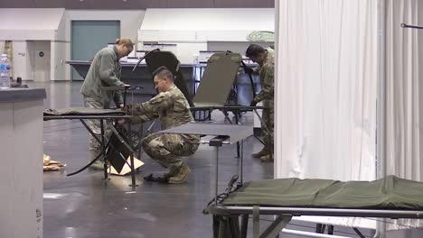 National-Guardsmen-Ready-The-Santa-Clara-Convention-Center-In-California-As-An-Emergency-Hospital-During-The-Coronavirus-Covid19-Outbreak-Epidemic