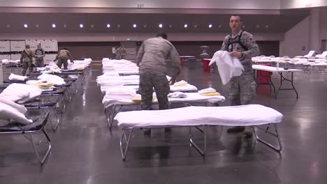 National-Guardsmen-Set-Up-Beds-And-Cots-At-The-Santa-Clara-Convention-Center-In-California-An-Emergency-Hospital-During-The-Coronavirus-Covid19-Outbreak-Epidemic-1