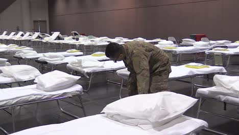 National-Guardsmen-Set-Up-Beds-And-Cots-At-The-Santa-Clara-Convention-Center-In-California-An-Emergency-Hospital-During-The-Coronavirus-Covid19-Outbreak-Epidemic-2