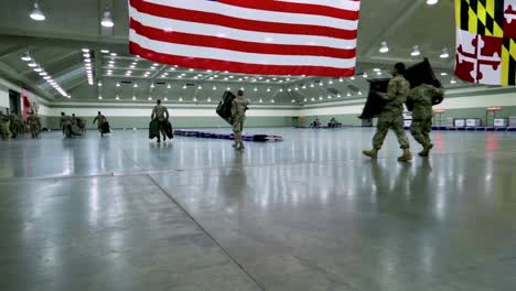 Maryland-National-Guardsmen-Set-Up-Beds-And-Cots-At-An-Emergency-Hospital-During-The-Coronavirus-Covid19-Outbreak-Epidemic-2