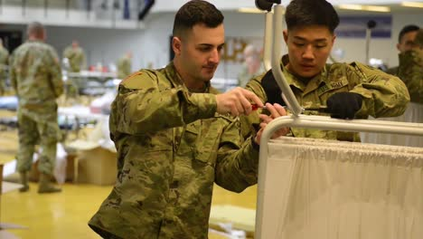 National-Guard-Troops-Set-Up-Emergency-Hospital-At-Connecticut-State-University-During-The-Coronavirus-Covid19-Epidemic-Emergency