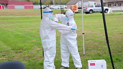 Covid19-Coronavirus-Nurses-Sanitize-Protective-Clothing-At-A-Drive-Thru-Clinic-Manned-By-National-Guard-Of-Tennessee