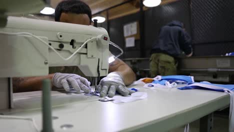 Corona-Virus-Protective-Masks-Are-Sewn-By-Hand-By-National-Guard-Troops-During-The-Covid19-Epidemic-Outbreak-Emergency-2