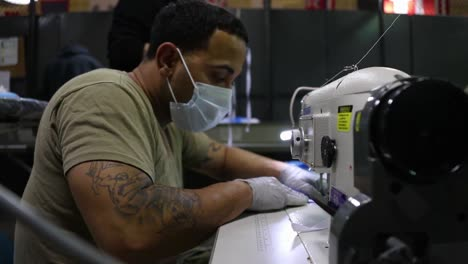 Corona-Virus-Protective-Masks-Are-Sewn-By-Hand-By-National-Guard-Troops-During-The-Covid19-Epidemic-Outbreak-Emergency-3