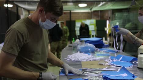 Corona-Virus-Protective-Masks-Are-Sewn-By-Hand-By-National-Guard-Troops-During-The-Covid19-Epidemic-Outbreak-Emergency-4