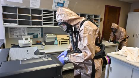 Members-Of-The-National-Guard-Sanitize-An-Office-Workspace-During-The-Coronavirus-Covid19-Outbreak-Pandemic-2