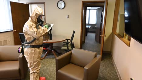 Members-Of-The-National-Guard-Sanitize-An-Office-Workspace-During-The-Coronavirus-Covid19-Outbreak-Pandemic-3