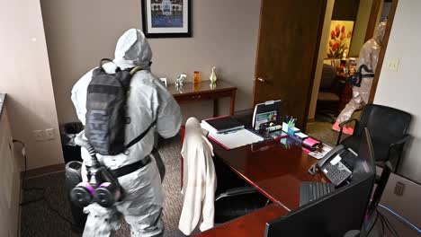 Members-Of-The-National-Guard-Sanitize-An-Office-Workspace-During-The-Coronavirus-Covid19-Outbreak-Pandemic-5
