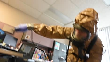Members-Of-The-National-Guard-Sanitize-An-Office-Workspace-During-The-Coronavirus-Covid19-Outbreak-Pandemic-6