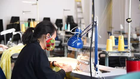 Private-Companies-Start-To-Make-Gowns-And-Masks-In-Small-Factories-During-The-Coronavirus-Covid19-Pandemic-Outbreak