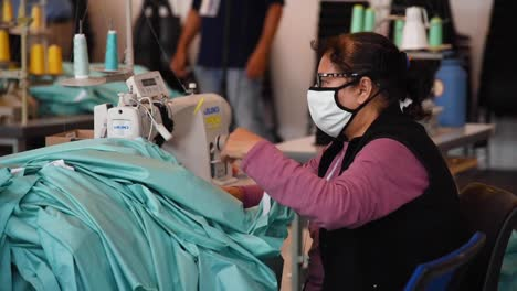 Private-Companies-Start-To-Make-Gowns-And-Masks-In-Small-Factories-During-The-Coronavirus-Covid19-Pandemic-Outbreak-3