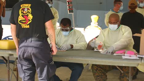 Sailors-On-The-Uss-Navy-Theodore-Roosevelt-Are-Tested-For-The-Coronavirus-Covid19-In-Guam-During-The-Peidemic-Outbreak-Onboard-The-Ship