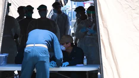 Us-Navy-Hospital-Corpsman-Test-Sailors-From-A-Ship-Upon-Arrival-In-America-During-The-Coronavirus-Covid19-Pandemic-Epidemic-Outbreak-Emergency