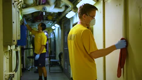 Sailors-Aboard-The-Aircraft-Carrier-Uss-Theodore-Roosevelt-Clean-Various-Spaces-With-Disinfectant-Bleach-During-The-Coronavirus-Covid19-Pandemic-Epidemic-Outbreak-2