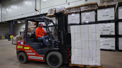 Rhode-Island-National-Guard-And-Fema-Workers-Track-Covid19-Coronavirus-Equipment-Inventory-And-Ship-Supplies-In-Warehouse-With-Forklift