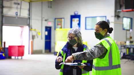 Rhode-Island-National-Guard-And-Fema-Workers-Track-Covid19-Coronavirus-Equipment-Inventory-And-Ship-Supplies-In-Warehouse-With-Forklift-1
