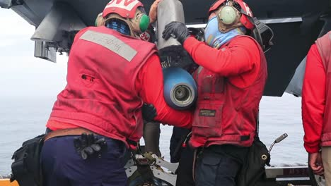 Sailors-On-the-Uss-Gerald-R-Ford-Load-Mk82-500-Lb-Inert-Bombs-And-Other-Ordnance-Onto-F/A-18-E-Super-Hornets