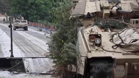 Us-And-Polish-Soldiers-Cross-A-River-In-Humvees-And-Bradley-Fighting-Vehicles-At-Drawsko-Pomorskie-Poland-2