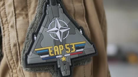 Close-Up-Shots-Of-A-French-Air-Force-Fighter-Pilot-His-Helmet-And-Uniform-Patches