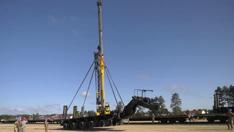A-Crane-Prepares-To-Lift-A-Trailer-Of-1158th-Transportation-Company-Of-Wisconsin-National-Guard-Onto-A-Rail-Car-2