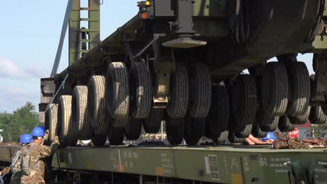 Crane-Lowers-A-Trailer-Onto-A-Rail-Car-While-1158th-Transportation-Company-Soldiers-Wisconsin-Nat-Guard-Position-It
