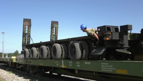 Crane-Lowers-A-Trailer-Onto-A-Rail-Car-While-1158th-Transportation-Company-Soldiers-Wisconsin-Nat-Guard-Position-It-1