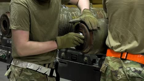 Us-Air-Force-Airmen-Of-332-Aew-Ammo-Shop-Assemble-Weapons-And-Munitions-For-A-Bombing-Mission
