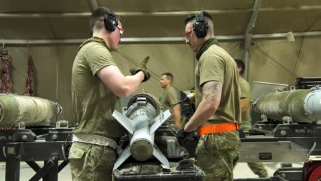 Us-Air-Force-Airmen-Of-332-Aew-Ammo-Shop-Assemble-Weapons-And-Munitions-For-A-Bombing-Mission-3