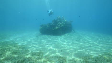 Underwater-footage-of-scuba-divers-exploring-a-sunken-tank-in-the-Red-Sea-near-Aqaba-Jordan